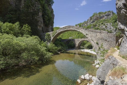 A cluster of 48 traditional picturesque villages (Epirus), built amphitheatrically in the wider area of Timfi, Pindos and Mitiskeli (Zagori region). Zagori's natural environment is exquisite and perfect for many outdoor activities. The local architecture is defined by stone, wood and slate rock